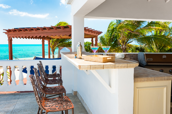 Veranda at Villa TNC COO (Conched Out) at Turks & Caicos, Long Bay Beach, Family-Friendly Villa, Pool, 7 Bedrooms, 7 Bathrooms, WiFi, WIMCO Villas