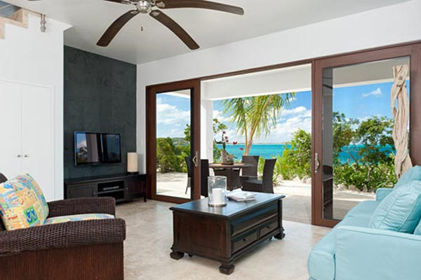Living Room at Villa TNC WED (Water Edge - The Cottages at Grace Bay) at Turks & Caicos, Grace Bay/Beachside, Pool, 1 Bedrooms, 2 Bathrooms, WiFi, WIMCO Villas